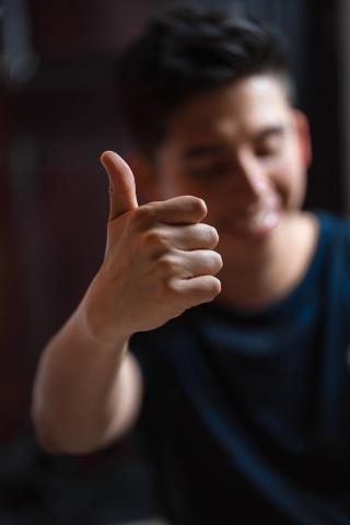 male with thumbs up